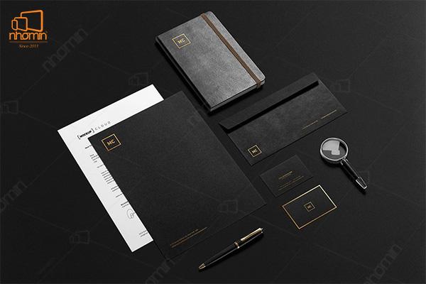 Mẫu thiết kế ấn phẩm văn phòng màu đen với logo ép kim sang trọng và tinh tế