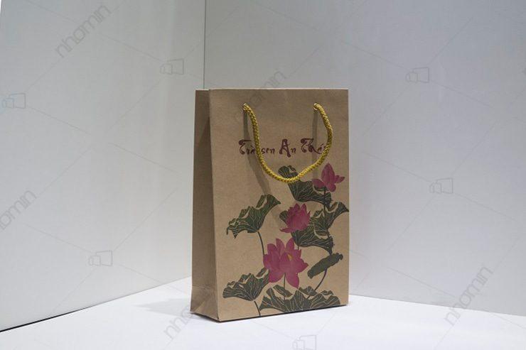mẫu túi giấy bảo vệ môi trường trà sen an thái